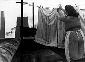 Woman hanging out washing whilst the smoke from the colliery is blowing in another direction, Horden pit village, County Durham, 1948 - Elisabeth Chat - 01-06-1948