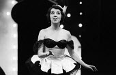 Actor Fanny Carby in Theatre Workshop production of Oh What A Lovely War! directed by Joan Littlewood at Theatre Royal Stratford East 1963 - Romano Cagnoni - 1960s,1963,ACE,acting,actor,actors,actress,actresses,Arts,cities,city,Culture,drama,DRAMATIC,Fanny Carby,FEMALE,maker,makers,making,musical,Oh What A Lovely War,people,person,persons,play,PLAYING,play