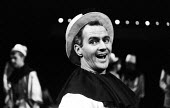 Choreographer and actor Bob Stevenson in Theatre Workshop production of Oh What A Lovely War! directed by Joan Littlewood at Theatre Royal Stratford East 1963 - Romano Cagnoni - 1960s,1963,ACE,acting,actor,actors,Arts,Bob Stevenson,cities,city,Culture,drama,DRAMATIC,maker,makers,making,male,man,men,musical,Oh What A Lovely War,people,person,persons,play,PLAYING,plays,producti