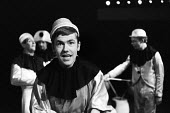 Actor Larry Dann in Theatre Workshop production of Oh What A Lovely War! directed by Joan Littlewood at Theatre Royal Stratford East 1963 - Romano Cagnoni - 1960s,1963,ACE,acting,actor,actors,Arts,cities,city,Culture,drama,DRAMATIC,Larry Dann,maker,makers,making,male,man,men,musical,Oh What A Lovely War,people,person,persons,play,PLAYING,plays,production,