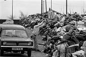 Glasgow dustcart drivers strike, 1975. Rubbish piled high in the street. The strike was eventually broken by the army - Peter Arkell - 18-03-1975