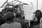 Army trucks push past pickets outside rubbish depot. Glasgow dustcart drivers strike 1975. Army was sent in by Labour government to break the strike - Peter Arkell - 20-03-1975