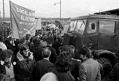 Glasgow dustcart drivers strike, 1975. Pickets, supported by EEPTU, block the entrance to rubbish depot to army vehicles. Army was sent in by Labour government to break the strike - Peter Arkell - 21-03-1975