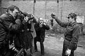 Glasgow dustcart drivers strike 1975. Army cadet holds up a dead rat. Government and health authorities were worried by a plague of rats during the strike. Army was sent in by Labour government to bre... - Peter Arkell - 19-03-1975
