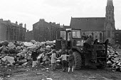 Glasgow dustcart drivers strike, 1975. Soldiers collecting rubbish. Army was sent in by Labour government to break the strike - Peter Arkell - 27-03-1975