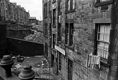 Housing in Glasgow, tenements 1975 - Peter Arkell - 1970s,1975,excluded,exclusion,Glasgow,Glasgow slums,Glasgow tenements,HARDSHIP,housing,Housing Estate,impoverished,impoverishment,INEQUALITY,Marginalised,people,POOR,poverty,precariat,precarious,Scotl