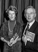 Norris McWhirter at launch of book about twin brother Ross, murdered by the IRA. With him was Ross wife Rosemary. Norris was co founder with his brother Ross of the Guinness Book of Records. He later... - Peter Arkell - 1970s,1977,ACE,activist,activists,Arts,author,authors,book,book launch,books,CAMPAIGN,campaigner,campaigners,CAMPAIGNING,CAMPAIGNS,Culture,Far Right,Far Right,FEMALE,Freedom,Freedom Association,Guinne