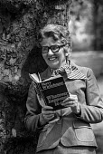 Mary Whitehouse with her book Whatever Happened to Sex?, Green Park, London - Peter Arkell - 25-05-1977