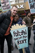 Picturehouse workers at Ritzy cinemas on 24 hour strike, rally in Leicester Square the center of the London cinema scene in protest at the continuing refusal by Cineworld to pay them the London Living... - Stefano Cagnoni - 2010s,2017,activist,activists,BAME,BAMEs,BECTU,black,Black and White,BME,bmes,CAMPAIGN,campaigner,campaigners,CAMPAIGNING,CAMPAIGNS,cinema,Cineworld,DEMONSTRATING,demonstration,DEMONSTRATIONS,disputes