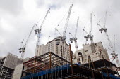 Cranes dotting the skyline on a major construction site on the old Shell building on the South Bank of London - Stefano Cagnoni - 2010s,2017,Bank,BANKS,Brownfield Site,building,building site,BUILDINGS,Carillion,cities,City,Construction Industry,construction site,crane,cranes,EBF,Economic,economy,levels,London,PFI,Private Finance