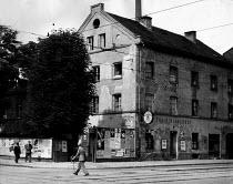 Street scene in post war Munich Germany 1949 - Hannes Rosenberg - 1940s,1949,advert,ADVERTISED,advertisement,advertisements,advertising,ADVERTISMENT,bar,bars,cane,cities,City,EBF,Economic,Economy,eu,Europe,european,europeans,eurozone,german,germans,Germany,male,man,