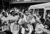 Muhammad Ali visiting Great Ormond Street Hospital London 1977. Ali holds up 2 children at the famous paediatric hospital, he was visiting the famous paediatric hospital to help raise money for it - NLA - 1970s,1977,African American,African Americans,Ambulance,ambulances,BAME,BAMEs,black,Black and White,BME,bmes,boxer,boxers,boy,boys,charitable,charity,child,CHILDHOOD,children,cities,city,diversity,eth