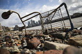 Abandoned washed up Tesco supermarket shopping trolley, Canary Wharf, River Thames, Limehouse, Docklands, London - Jess Hurd - 05-03-2017