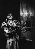Bob Dylan playing a gig with folk singer Dave Van Ronk in a club in Greenwich Village, New York, 1961 before the first Bob Dylan album - NLA - 1960s,1961,ACE,acoustic,Arts,Bob Dylan,club,clubs,Composer,Composers,concert,concerts,Culture,Dave Van Ronk,folk music,Greenwich Village,guitar,guitars,MacDougal Street,melody,music,MUSICAL,musical in