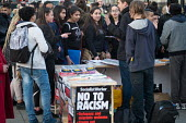 French school students at Socialist Worker stall. Defend EU Migrants Right to Remain protest during as Parliament votes to trigger Article 50, Parliament Square London - Philip Wolmuth - 2010s,2017,activist,activists,Anti Racism,anti racist,Brexit,CAMPAIGN,campaigner,campaigners,CAMPAIGNING,CAMPAIGNS,DEMONSTRATING,demonstration,DEMONSTRATIONS,Diaspora,EU,Europe,European Union,foreign,