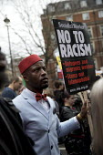 Stand up to Racism protest, UN Anti Racism Day, London - Jess Hurd - 2010s,2017,activist,activists,Anti Racism,anti racist,BAME,BAMEs,BANNER,banners,bigotry,Black,Black and White,BME,bmes,CAMPAIGN,campaigner,campaigners,CAMPAIGNING,CAMPAIGNS,Day,DEMONSTRATING,demonstra