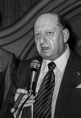 Impresario Lew Grade at a press conference, London - Peter Arkell - 1970s,1977,ace,boss,bosses,cigar,conference,conferences,culture,entertainment,impresario,Impresarios,Lew Grade,London,London Weekend Television,LWT,male,man,management,manager,managers,managing,men,pe