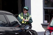 Civil Enforcement Officer giving a parking ticket, Stratford upon Avon, Warwickshire - John Harris - 30-03-2017