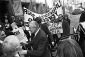 James Callaghan walking through a lobby campaigning against the deportation of former CIA agent Philip Agee and journalist Mark Hosenball, outside a meeting of Greater London Labour Party 1977 - NLA - 1970s,1977,activist,activists,against,Agee and Hosenball campaign,Callaghan,campaign,campaigner,campaigners,campaigning,CAMPAIGNS,DEMONSTRATING,Demonstration,DEMONSTRATIONS,deportation,deportations,de