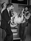 The Goodies (L-R) Graeme Garden, Tim Brooke-Taylor and Bill Oddie with a turkey. Press conference to publicise a new BBC 2 TV series - NLA - 1970s,1978,ace,BBC,Bill Oddie,conference,conferences,culture,entertainment,funny,Garden,GARDENS,Graeme Garden,humor,humorous,HUMOUR,joking,male,man,men,people,person,persons,The Goodies,Tim Brooke-Tay