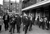 Harold Wilson visiting council housing estate, Notting Hill, London, 1972 to draw attention to poor housing. Journalist with a tape recorder - Peter Arkell - 10-07-1972