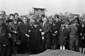 Funeral of Fred Matthews killed by a scab lorry while picketing a Keadby Power Station during the 1972 miners strike, Doncaster. 5,000 miners attended the funeral of the NUM member from Hatfield colli... - Peter Arkell - 1970s,1972,1972 miners strike,adult,adults,Belief,cemeteries,cemetery,collieries,colliery,conviction,DISPUTE,disputes,faith,families,family,FEMALE,Fred Matthews,funeral,funerals,GOD,grave,graves,grave