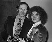Johnny Dankworth with Cleo Laine. Joint Show Business Personality of the Year Award of 1977 - Peter Arkell - 1970s,1977,ACE,Arts,BAME,BAMEs,Black,Black and White,BME,bmes,Business,Cleo Laine,Culture,diversity,entertainment,ethnic,ethnicity,jazz,Johhny Dankworth,male,man,melody,men,minorities,minority,multi c
