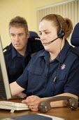 Control room operators traning, Avon Fire and Rescue South West Command Development Centre (SWCDC), Lansdown near�Bath, a high tech centre for command training and incident simulation - Paul Box - 2000s,2008,adult,adults,answer,answering,answers,audio,calls,Command,COMPUTE,computer,computers,COMPUTING,control centre,control room,Development,DIA,earphone,earphones,earpiece,Emergency Services,emp