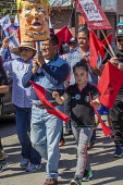 Salinas, Californi, USA Migrant farm workers celebrate Cesar Chavez Day with a Resist Trump march. Protest against anti immmigrant actions and statements by President Donald Trump. Organized by the UF... - David Bacon - 02-04-2017
