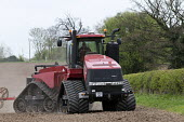 Farmer planting spring wheat with a tracked tractor Case IH Quadtrac 600 and Rapid seed drill, Warwickshire - John Harris - 07-04-2017