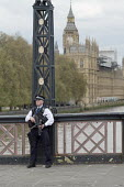 Armed police officer, Lambeth Bridge, London during the funeral of PC Keith Palmer - Philip Wolmuth - CTSFO,2010s,2017,adult,adults,armed,arms,Big Ben,bridge,bridges,cities,City,CLJ,confidence patrol,Counter Terrorist Specialist Firearms Officer,firearm,firearms,force,funeral,FUNERALS,guard,guarding,g