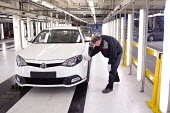 Worker inspecting the finish and paintwork of an MG6, thefirst new MG model for 16 years, MGMotor UK Ltd, Longbridge - Timm Sonnenschein - 13-04-2011