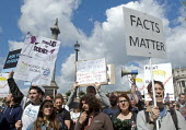 March For Science, London. International protest on Earth Day against global political questioning of facts and for protection the environment - Stefano Cagnoni - 2010s,2017,activist,activists,against,CAMPAIGN,campaigner,campaigners,CAMPAIGNING,CAMPAIGNS,DEMONSTRATING,demonstration,DEMONSTRATIONS,environment,facts,FEMALE,March for Science,Nelsons Column,people,