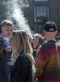 Ann Arbor, Michigan USA. Thousands attended the annual Hash Bash a 45-year tradition advocating the legalization of marijuana, University of Michigan - Jim West - 2010s,2017,ACE,America,Ann Arbor,campus,CAMPUSES,cannabis,counterculture,dope,DRUG,drugs,Festival,festivals,freedom,grass,Hash Bash,illegal,legalisation,legalization,marijuana,Michigan,people,person,p
