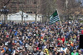 Ann Arbor, Michigan USA. Thousands attended the annual Hash Bash a 45-year tradition advocating the legalization of marijuana, University of Michigan - Jim West - 2010s,2017,ACE,America,Ann Arbor,campus,CAMPUSES,cannabis,counterculture,dope,DRUG,drugs,Festival,festivals,flag,flags,freedom,grass,Hash Bash,illegal,legalisation,legalization,marijuana,Michigan,PEOP