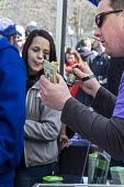 Ann Arbor, Michigan USA. A vendor sells non psychoactive tinctures made from industrial hemp. Thousands attended the annual Hash Bash a 45-year tradition advocating the legalization of marijuana, Univ... - Jim West - 2010s,2017,ACE,America,Ann Arbor,business,campus,CAMPUSES,cannabis,cash,commerce,counterculture,dope,DRUG,drugs,Festival,festivals,freedom,grass,Hash Bash,hemp tincture,illegal,legalisation,legalizati