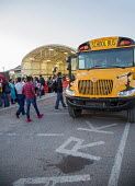 USA Mexican Border. Pupils from Palomas in Mexico Boarding buses in the morning to attend school in Columbus USA. All are US citizens, many living in Palomas with deported parents Others were born in... - Jim West - 2010s,2017,adolescence,adolescent,adolescents,america,American,americans,americas,boarding,border,border control,border controls,border crossing,border town,borders,boy,boys,bus,bus service,buses,chil