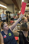 Mesa, Arizona, USA Constituents who support the Affordable Care Act argue with Republican Senator Jeff Flake at a town hall meeting. Many oppose a Mexican border wall. Susie Bell of Gilbert, Arizona s... - Jim West - 13-04-2017