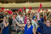 Mesa, Arizona, USA Constituents who support the Affordable Care Act argue with Republican Senator Jeff Flake at a town hall meeting. Many oppose a Mexican border wall. Audience members holding up red... - Jim West - 2010s,2017,ACA,Affordable Care Act,America,anger,angry,Arizona,Audience,AUDIENCES,border,care,Congress,constituents,critic,criticism,critique,debate,debating,democracy,disagree,disagreement,disapprova