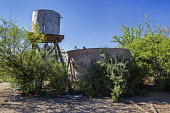 Tucson, Arizona, USA A water tank used by ranchers for cattle in the desert. A cross indicates that an immigrant died here when he climbed in to get water and drowned when he could not get out. Hundre... - Jim West - 18-04-2017