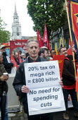 2017 May day Demonstration London Campaigner Peter Tatchell on the march - Stefano Cagnoni - 2010s,2017,activist,activists,AFFLUENCE,AFFLUENT,against,anti,Austerity Cuts,Bourgeoisie,CAMPAIGN,campaigner,campaigners,CAMPAIGNING,CAMPAIGNS,cuts,DEMONSTRATING,demonstration,DEMONSTRATIONS,elite,eli