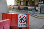 Nogales, Arizona, USA sign at the pedestrian US Mexican border crossing warning that guns and ammunition are prohibited - Jim West - 2010s,2017,America,american,americans,americas,Arizona,armed,arms,ban,banning,bans,border,border control,border controls,border crossing,borders,CLJ,communicating,communication,Crime,cross,crosses,cro