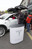 Tesla electric car trade stand Stratford Festival of Motoring, Warwickshire - John Harris - 2010s,2017,auto,AUTOMOBILE,AUTOMOBILES,AUTOMOTIVE,Automotive Industry,car,cars,EBF,Economic,Economy,electric,Festival,FESTIVALS,Lithium battery,low emission,low emissions,male,man,men,people,person,pe