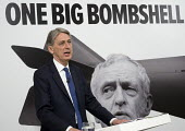 Philip Hammond speaking Conservative party general election press conference, Westminster, London - Philip Wolmuth - 2010s,2017,anti Corbyn,billboard,billboards,campaign,campaigning,CAMPAIGNS,conference,conferences,CONSERVATIVE,Conservative Party,conservatives,debt,debts,DEMOCRACY,ELECTION,elections,General Election