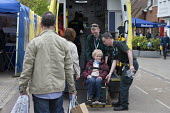 Paramedics loading an elderly woman into an ambulance - John Harris - 30-04-2017