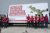 Labour Party general election campaign poster launch, London - Philip Wolmuth - 2010s,2017,adolescence,adolescent,adolescents,advertisement,advertisements,advertising,billboard,billboards,campaign,campaigning,CAMPAIGNS,DEMOCRACY,election,elections,FEMALE,HAULAGE,HAULIER,HAULIERS,