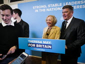 Conservative supporters line up to posing for photograhs in front of the stage set after Theresa May speech, General election campaign, Linskill Centre, North Shields - Mark Pinder - 2010s,2017,amateur,campaign,campaigning,CAMPAIGNS,CONSERVATIVE,Conservative Party,conservatives,DEMOCRACY,ELECTION,elections,General Election,male,man,men,people,person,persons,photograph,photographs,