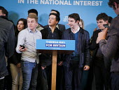 Conservative supporters line up to posing for photograhs in front of the stage set after Theresa May speech, General election campaign, Linskill Centre, North Shields - Mark Pinder - 2010s,2017,amateur,CAMERA,camera phone,cameras,campaign,campaigning,CAMPAIGNS,CELLULAR,CONSERVATIVE,Conservative Party,conservatives,DEMOCRACY,ELECTION,elections,General Election,male,man,men,mobile p