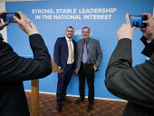 Conservative supporters line up to posing for photograhs in front of the stage set after Theresa May speech, General election campaign, Linskill Centre, North Shields - Mark Pinder - 12-05-2017