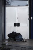 Homeless man sleeping in the doorway of an closed bank, Newcastle Upon Tyne - Mark Pinder - 2010s,2017,bank,banks,cities,City,closed,closing,closure,closures,door,doors,doorway,excluded,exclusion,HARDSHIP,homeless,homelessness,impoverished,impoverishment,INEQUALITY,male,man,Marginalised,men,